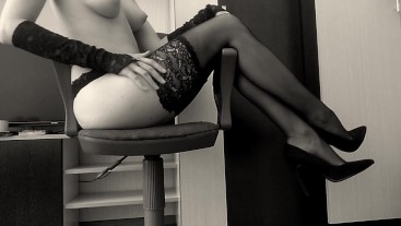Hot girl in stockings on high heels masturbates in an office chair and cums