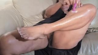 Sexy mature Latina woman shaving legs and having orgasms
