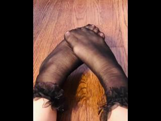 Rubbing Ruffled Stocking Feet