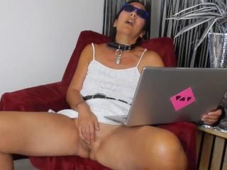 Milf masturbates watching porn...