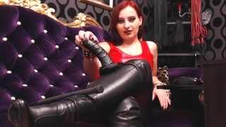 Red haired mistress domination a male slave doll