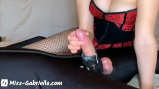 Chastity Slave Gets A Painful Handjob From His Femdom Mistress Wearing A Corset & Fishnets