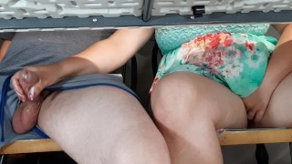 Step mom gives son unwanted handjob at beachside cafe under table.