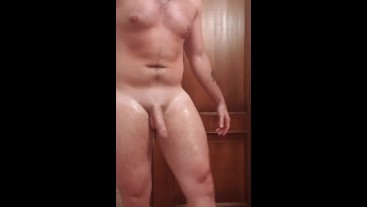 Naked oil quad flex and hung uncut cock touching