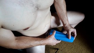 Thick chested stud smokes while jerking off with fleshlight toy