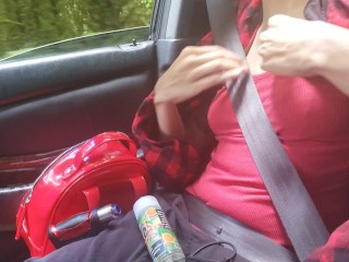 Cutie flashing her tits in the car!