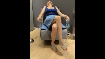 Crossed legs masturbation in furniture store