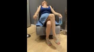 Crossed legs masturbation in furniture store