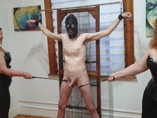 Dominatrix duo beats slaves cock with floggers riding...