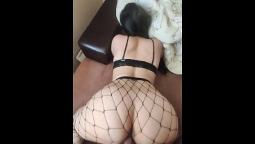 White girl with long hair using Fishnet socks fucking on the couch