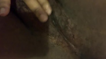 Ebony girl plays with her hairy pussy