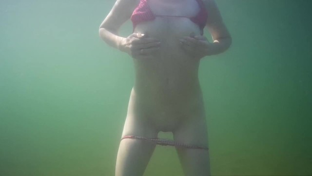 Sexy sluts on the beach Wife caresses herself underwater on a public beach