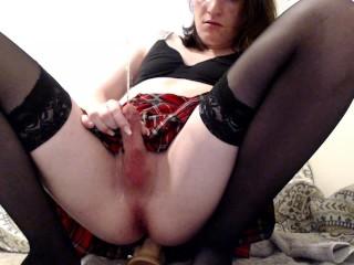 Naughty shemale school girl fucks dildo pees...
