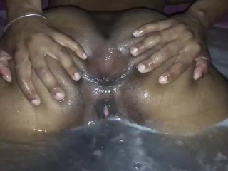 Spreads her ass wide to get soaked down...