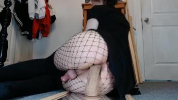 Goth trap in fishnets uses a big dildo