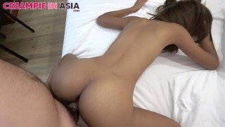 Big booty Asian babe didnt see me take the condom off