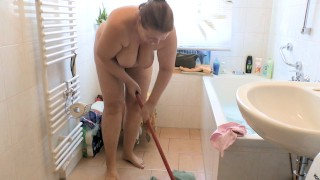 Naked cleaning in the bathroom