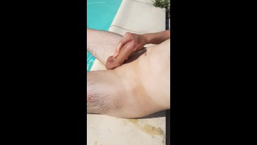Young twink with huge cock shows off at the campsite swimming pool