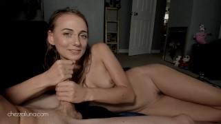 Sexy girlfriend giving encouraging handjob