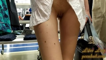 In a mini dress and no panties in the store (upskirt)