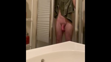 College guy drying off with a towel after a shower