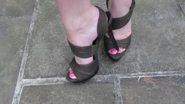 Femdom showing off new pedicure in sexy high Stilettos