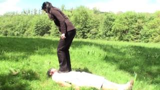 Goddess Gloria trample her slave outdoor