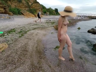 Naked girl walks along vacation without clothes...