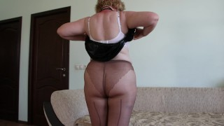 A mature housewife puts nylon tights on plump legs Homemade foot fetish