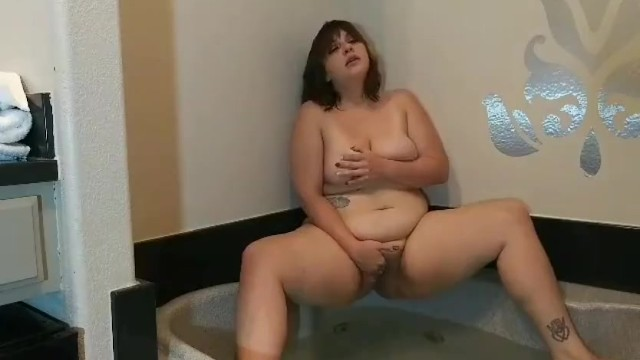 Thick girl having some fun in a tub 11