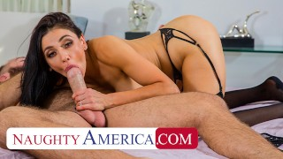 Screen Capture of Video Titled: Naughty America - Audrey Bitoni lets her husband's employee test drive her pussy!!