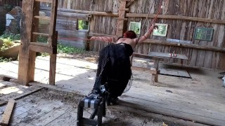 Tied up and fucked by machine in barn