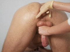 a masseuse with big tits gives the client a prostate massage in rubber gloves and jerks off a dick.