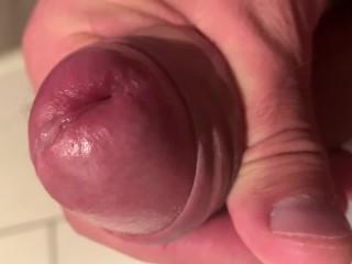 Stroking a drop of pre cum...