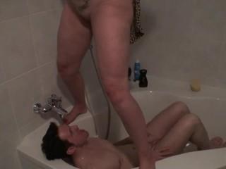 Pissing bobby get golden shower in bathtube...