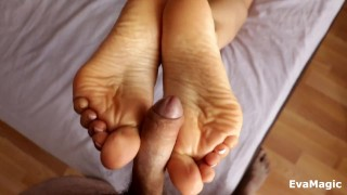 Screen Capture of Video Titled: HELPED MY STEP BROTHER CUM - AMAZING FOOTJOB AND CUM ON SEXY SOLES