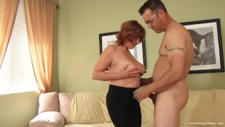 Big tit redhead cougar cheats with her younger neighbor