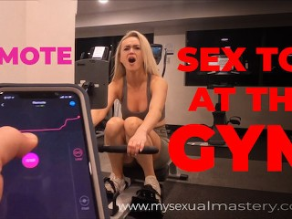 Sexy Girl Working out with Remote Control Sex Toy in Public Gym