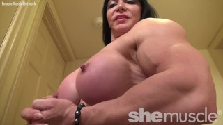 A mature naked female bodybuilder with huge tits poses
