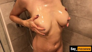 MILF with big tits showering her holes