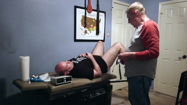Sir G gives me a medical exam before hooking up the electro to my cock and butt while spanking me