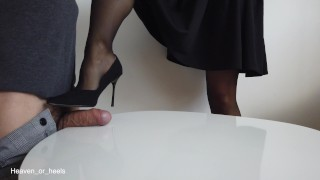 Dominant wife ruins slave's orgasm with a stocking footjob