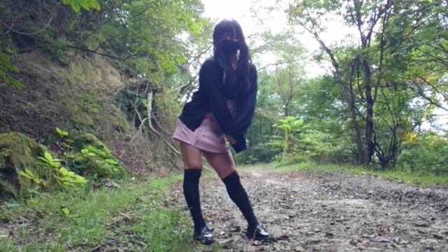 Cute little crossdresser masturbates and ejaculates in an untamed forest.