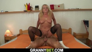Very old blonde in stockings rides stranger's cock