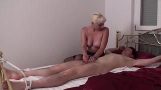 bounded slave get femdom handjob