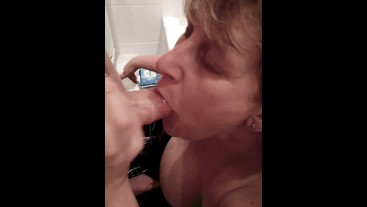 Filthy Mature Step Mom sucks cock in bath and gets a nasty facial.