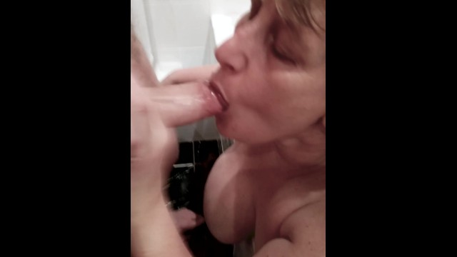 Filthy Mature Step Mom sucks cock in bath and gets a nasty facial. 13