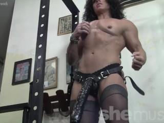 Sexy female bodybuilder Annie R shows off her huge strap on