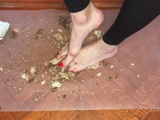 Kylie crushes wafers under her sexy bare feet...