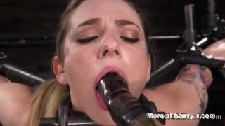 Blonde Restrained In Extreme Metal Bondage Device